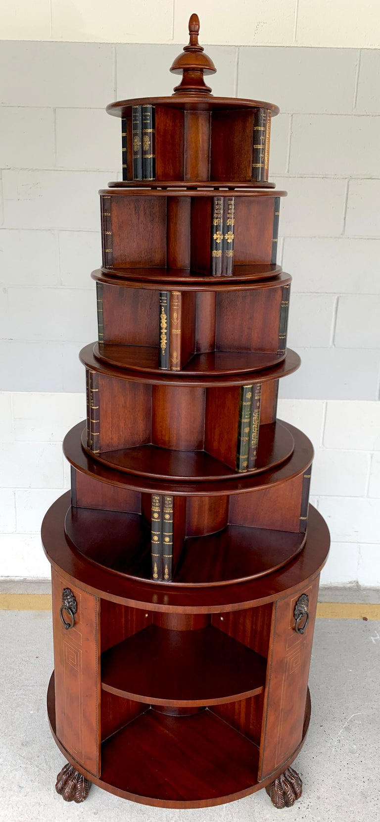 Georgian style six-tier faux book motif leather embossed revolving bookcase, impressive mahogany and embossed leather book motif revolving bookcase consisting of six graduating tiers.