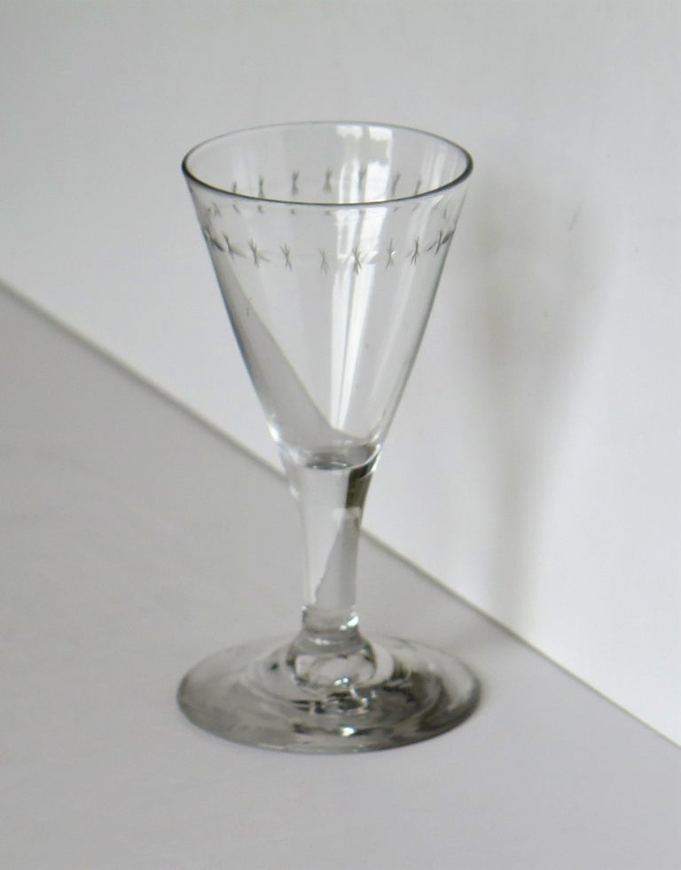 This is a good English, hand blown George 111rd period, engraved wine drinking glass, from the late 18th century, circa 1790. 