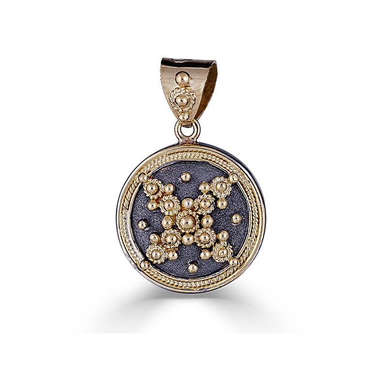 S.Georgios unique designer pendant all handmade from solid 18 Karat yellow Gold. This pendant is microscopically decorated - it has granulation work all the way around with gold beads and wires shaped as the last letter of the Greek Alphabet -