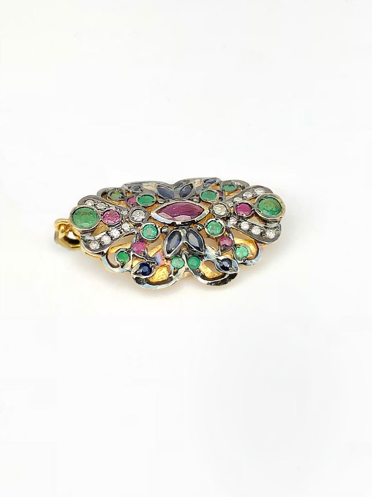 S.Georgios design Byzantine Pendant all handmade solid 18 Karat Yellow Gold. The pendant is decorated with diamonds total weight of 0.28 Carats and Emeralds, Rubies, and Sapphire total weight of 2.61 Carat. This art piece is made as an inspiration