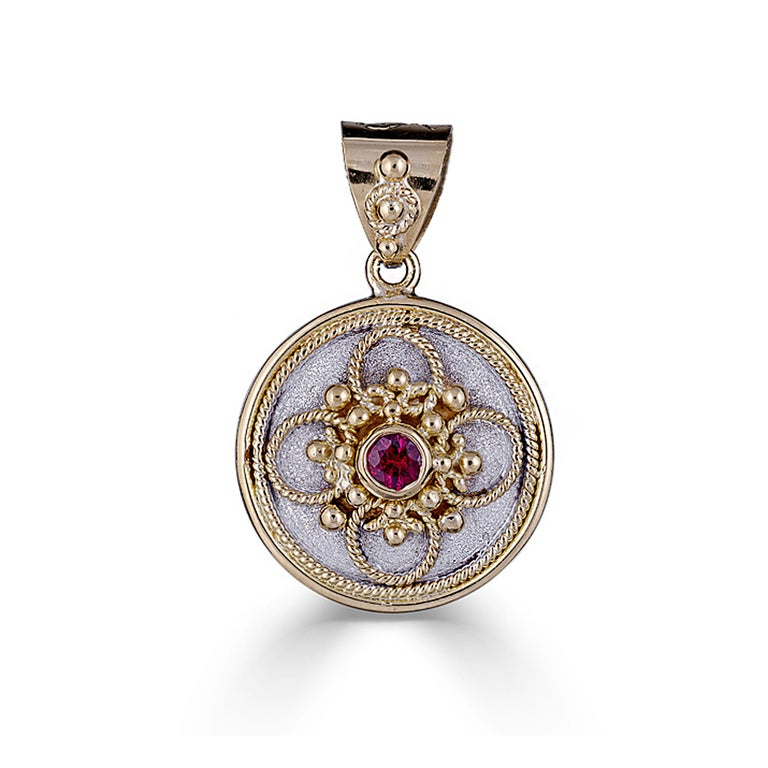 S.Georgios designer pendant all handmade from solid 18 Karat Yellow Gold. This pendant is microscopically decorated - it has granulation work all the way around with gold beads and wires shaped like the last letter of the Greek Alphabet - Omega,