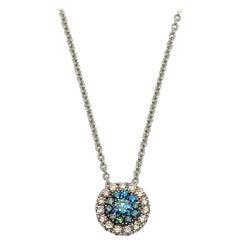 Georgios Collection 18 Karat White Gold Solitaire White and Blue Diamond Pendant