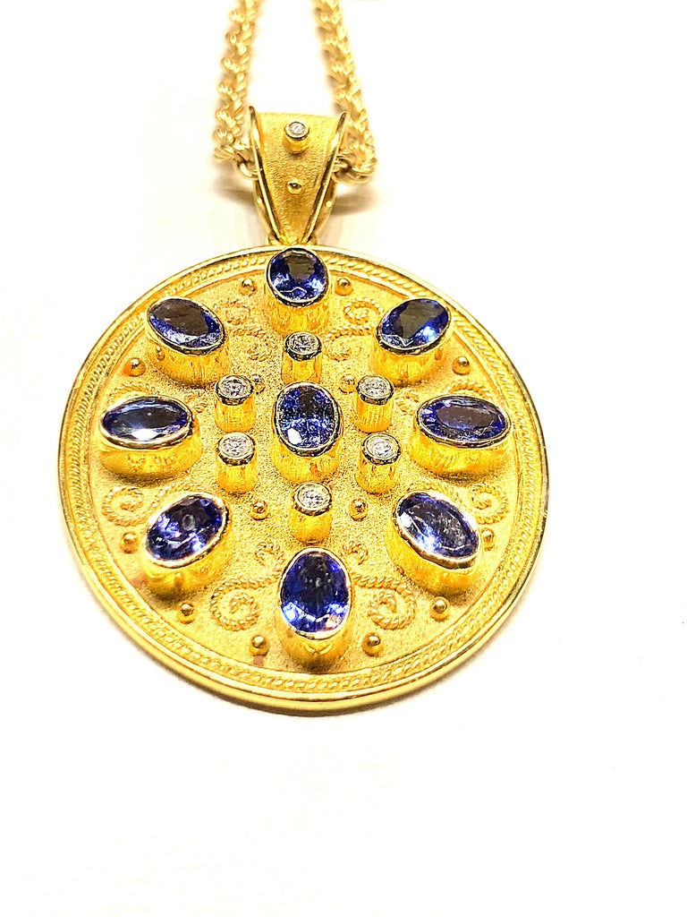 S.Georgios unique designer pendant all handmade in 18 Karat Yellow Gold. It's microscopically decorated - with granulation work all the way around in Gold 22 Karat beads and wires shaped like the last letter of the Greek Alphabet - Omega, which