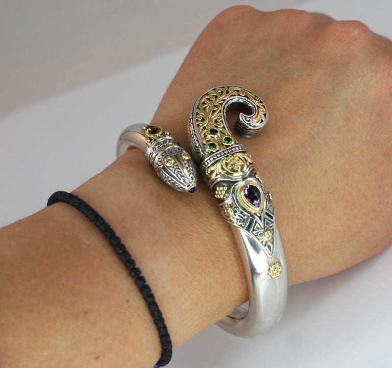Presenting all handmade heavy decorated cuff bracelet crafted from sterling silver and solid 18 Karat yellow gold to create a unique look. This animal-shaped bracelet features 1.52 Carat pear shape Amethyst, 0.80 Carat Pear shape Citrine, 0.30 Carat