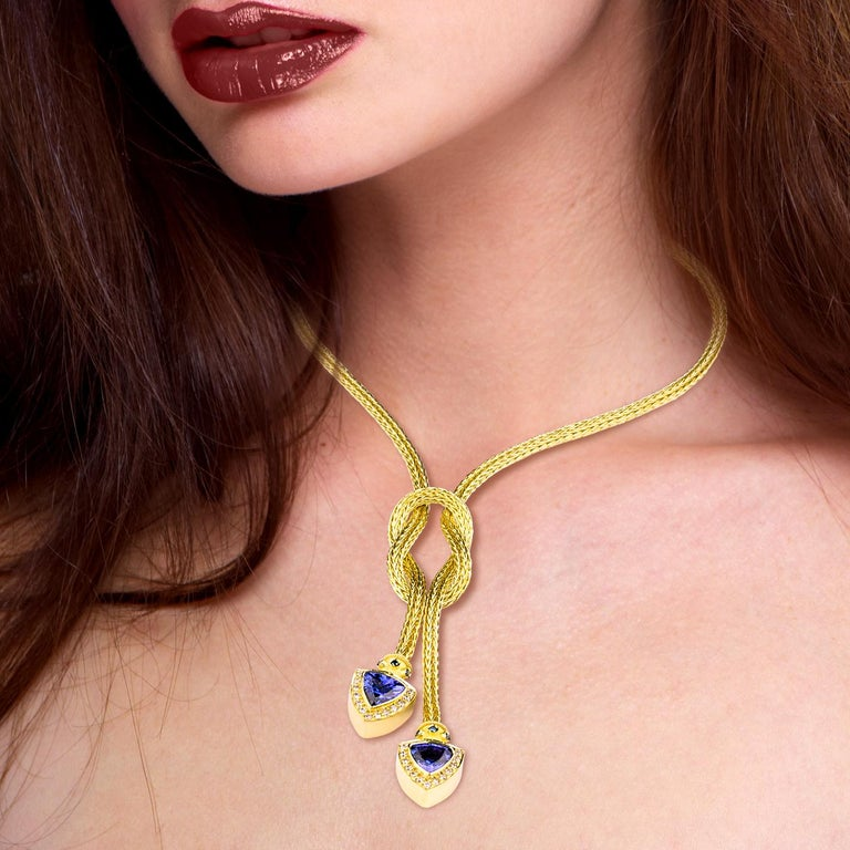 This is S.Georgios designer 18 Karat yellow gold hand-knitted rope necklace with Hercules Knot, which symbolizes strength, protection, and partnership. The ends of the rope are decorated with 2 trillion cut Tanzanites of total weight 6.85 Carat,