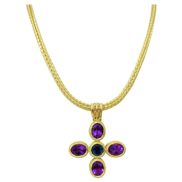 A unique S.Georgios designer reversible Cross Necklace is solid 18 Karat Yellow Gold all handmade with the Byzantine workmanship. It is decorated microscopically all the way around with granulation decors and the unique velvet effect on the