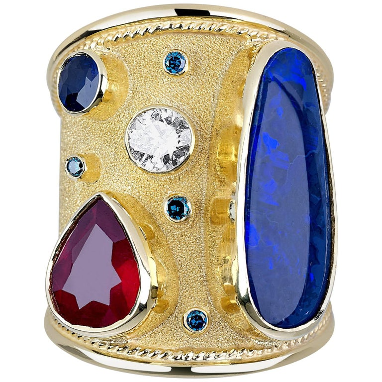 Georgios Collections 18 Karat Gold Ring with Opal Ruby Sapphire and Blue Diamond For Sale