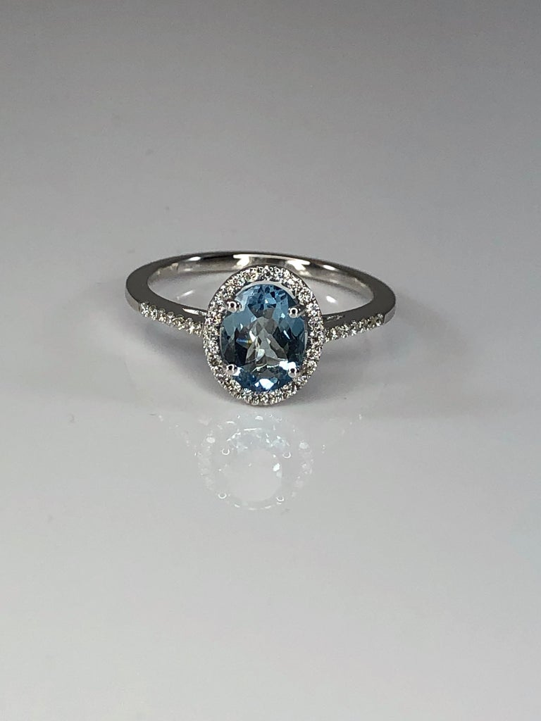 This is a gorgeous Aquamarine rosette ring from S.Georgios designer. The ring was handmade from 18 Karat White gold in Athens Greece. This solitaire ring features 1.11 Carat Aquamarine in oval cut, accompanied by Brilliant-cut White Diamonds, the