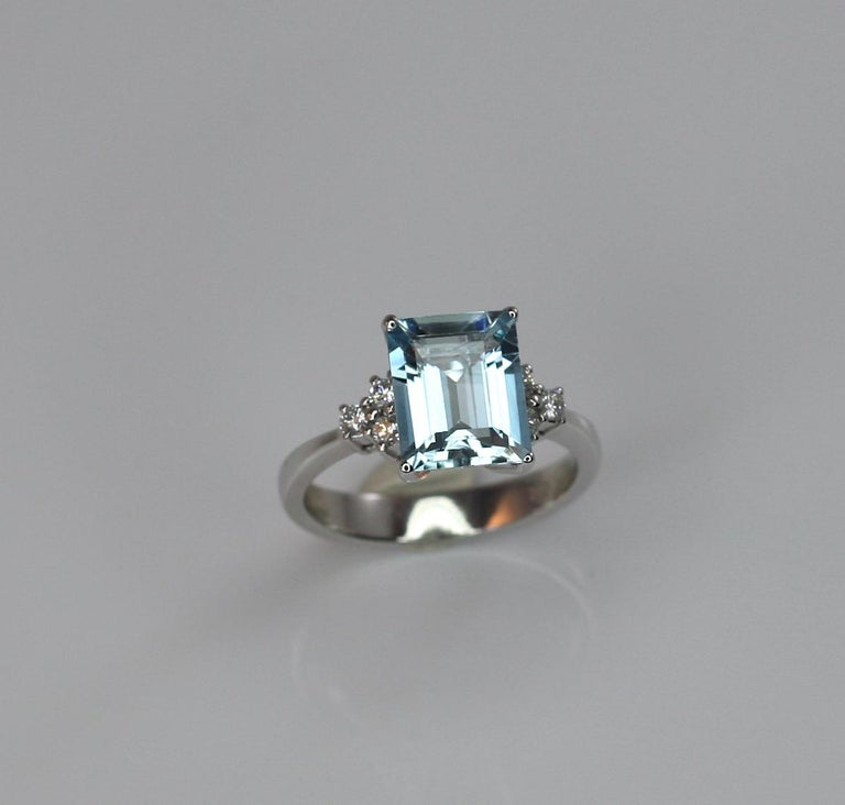 This gorgeous Aquamarine Ring designed by S.Georgios is all handmade in 18 Karat White gold and features a solitaire emerald cut Aquamarine of top quality the weight of 2,81 Carat. On the sides, we have set 6 Brilliant cut White Diamonds, the total