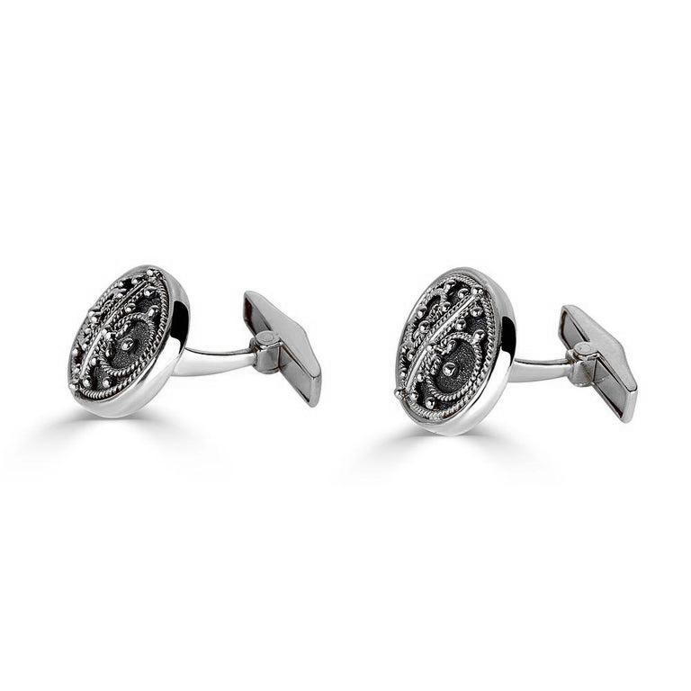 S.Georgios designer cufflinks handmade in 18 Karat white gold and Black Rhodium. Cufflinks are microscopically decorated with granulation work in Byzantine style and with unique velvet background. Also, the mechanism on the back is solid 18 Karat