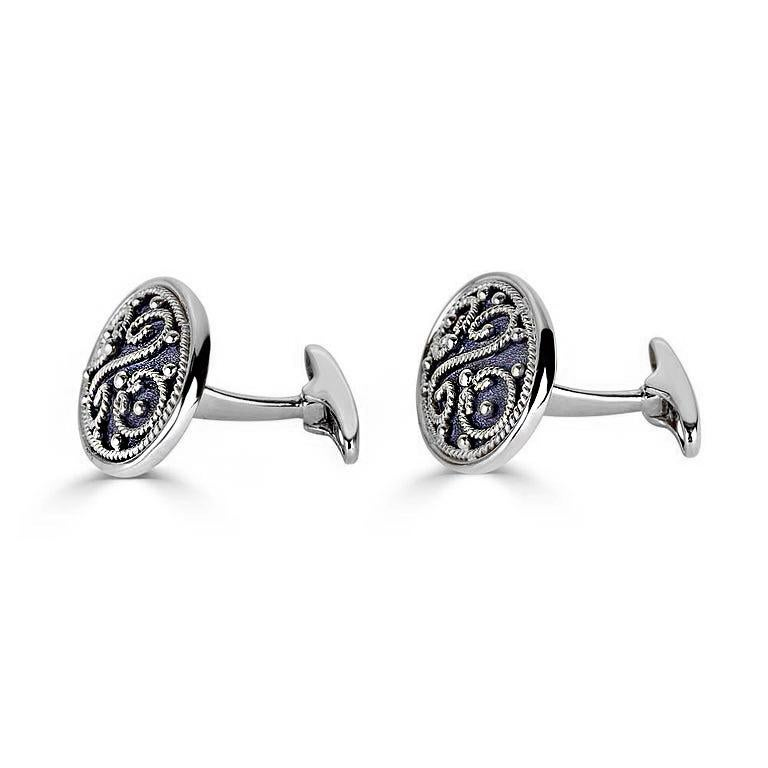 S.Georgios designer cufflinks handcrafted in Greece from 18 Karat white gold and black rhodium. Cufflinks are microscopically decorated with granulation work in Byzantine style and with a unique velvet background. Also, the mechanism on the back is