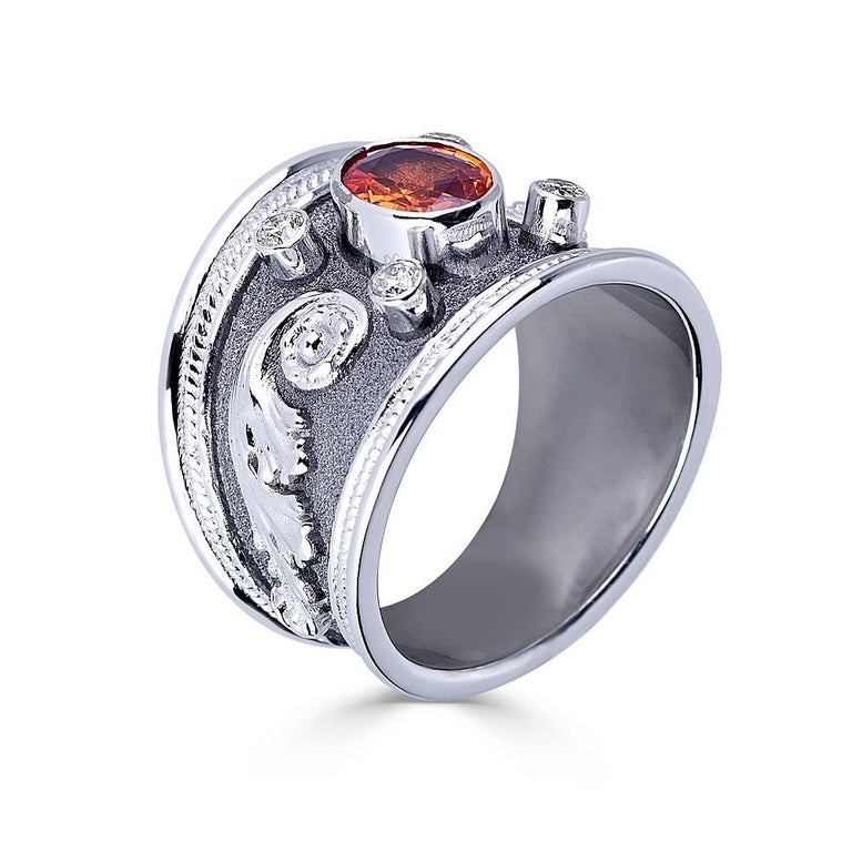 S.Georgios designer 18 Karat Solid White Gold Ring is all handmade with Byzantine granulation workmanship done all microscopically and has a unique velvet look on the background finished with Black Rhodium. The ring features an oval-cut Orange