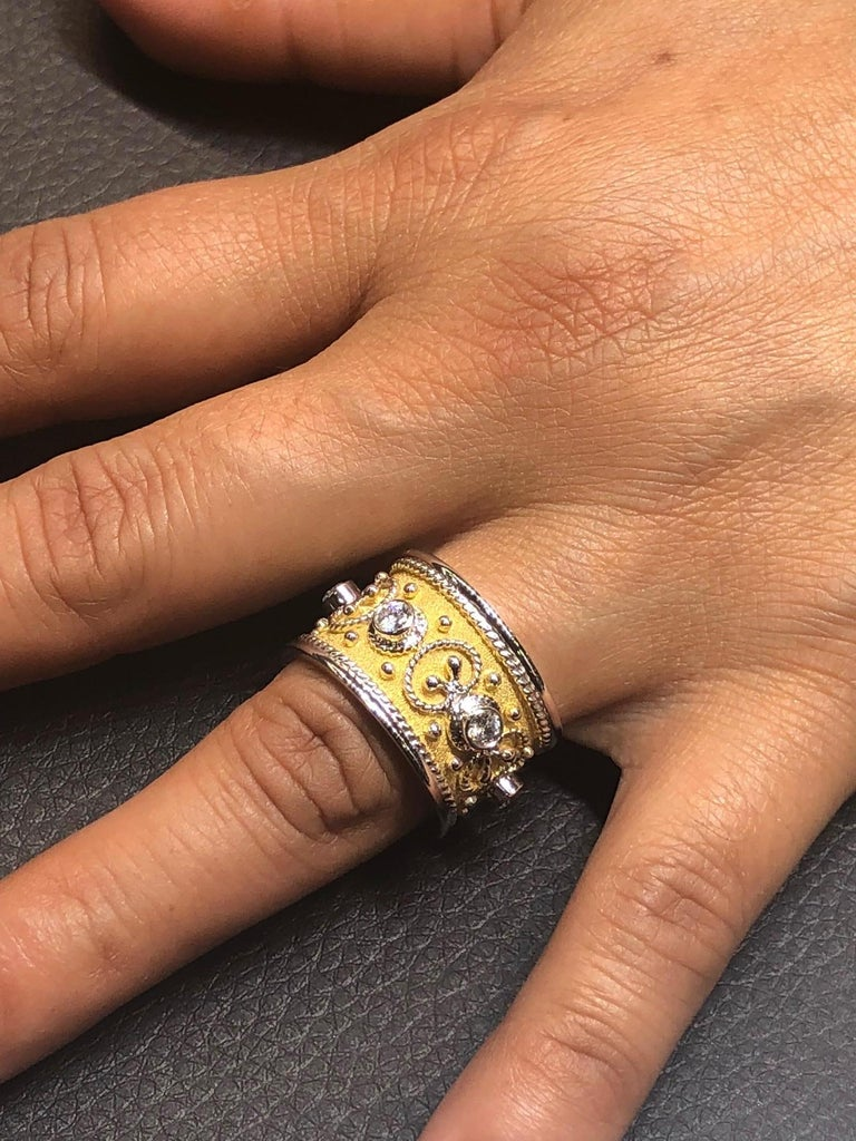 S.Georgios designer Band Ring all Handmade from solid 18 Karat White Gold. The beautiful art piece is microscopically decorated all the way around with white gold beads and wires shaped like the last letter of the Greek Alphabet - Omega, which