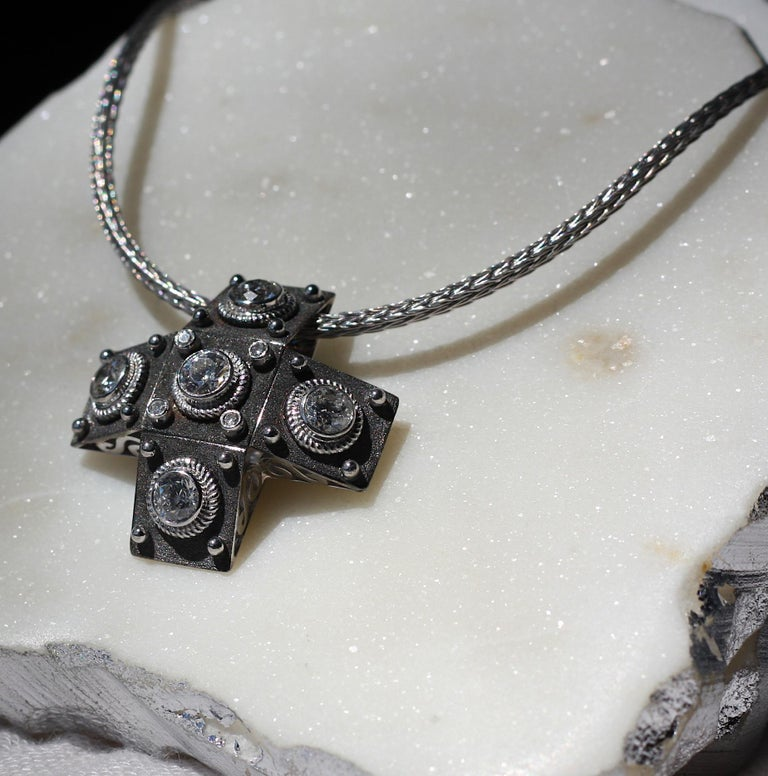 A unique S.Georgios designer Cross in solid 18 Karat White Gold all handmade with the Byzantine workmanship. This cross is decorated with granulation details and the unique Byzantine velvet surface finished with Black Rhodium, the most expensive