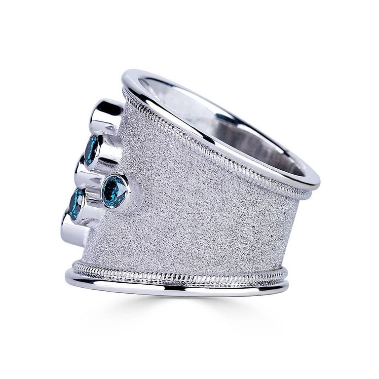 Unique S.Georgios designer Hand Made 18 Karat White Gold Ring. It is all custom made and has granulation work with twisted wire on the sides, and features 6 (six) Brilliant cut Blue Diamonds with total weight of 1.20 Carat and 3 (three)