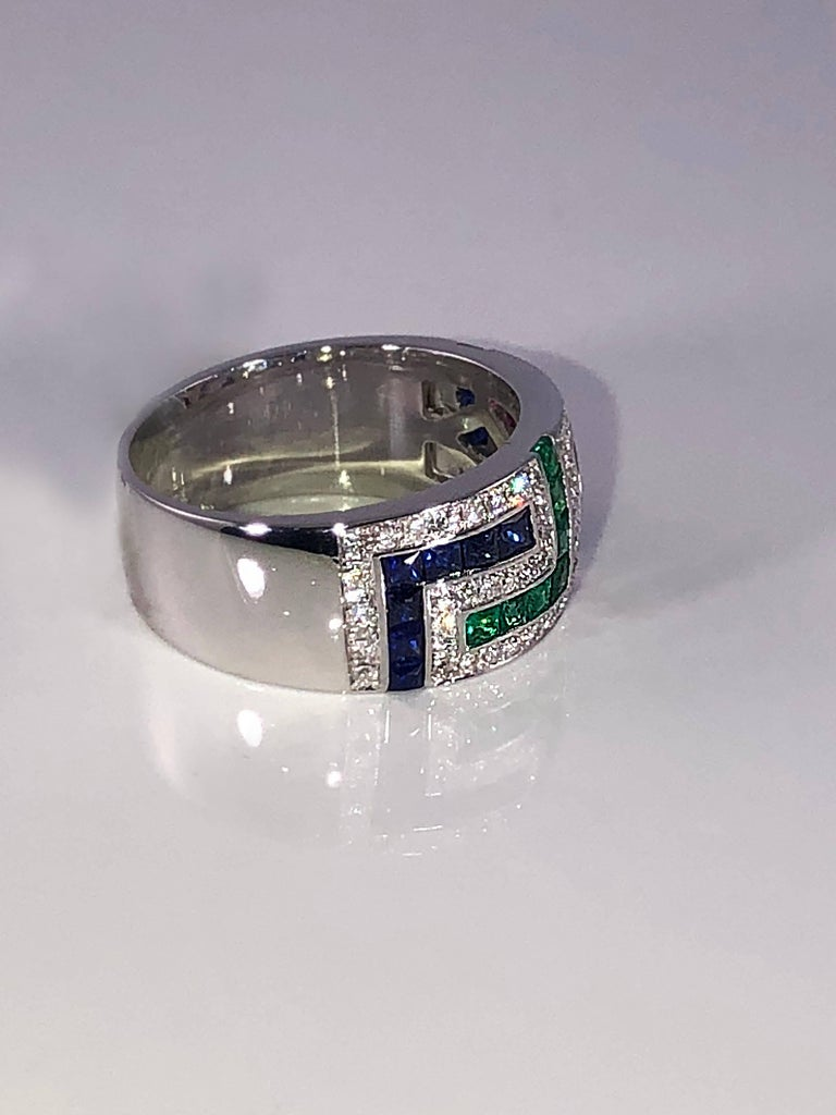 S.Georgios designer 18 Karat White Gold band Ring featuring the Greek Key design symbolizing eternity. It has Brilliant Cut White Diamonds total weight of 0.50 Carat, Princess cut Rubies, Sapphires and Emeralds total weight of 1.52 Carat. The