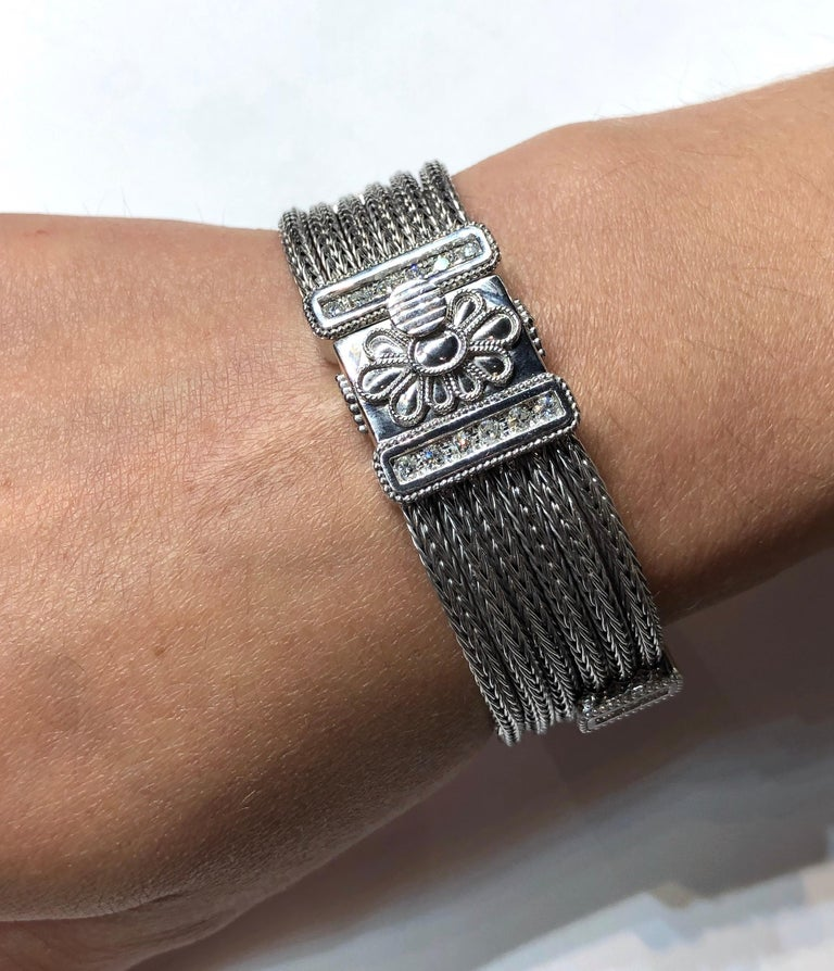S.Georgios designer handmade bracelet from 18 Karat white gold knitted in our workshop in Greece. This flexible bracelet is made from white gold threads knitted to ropes and decorated with 1.05 Carat Brilliant Cut White Diamonds and Byzantine