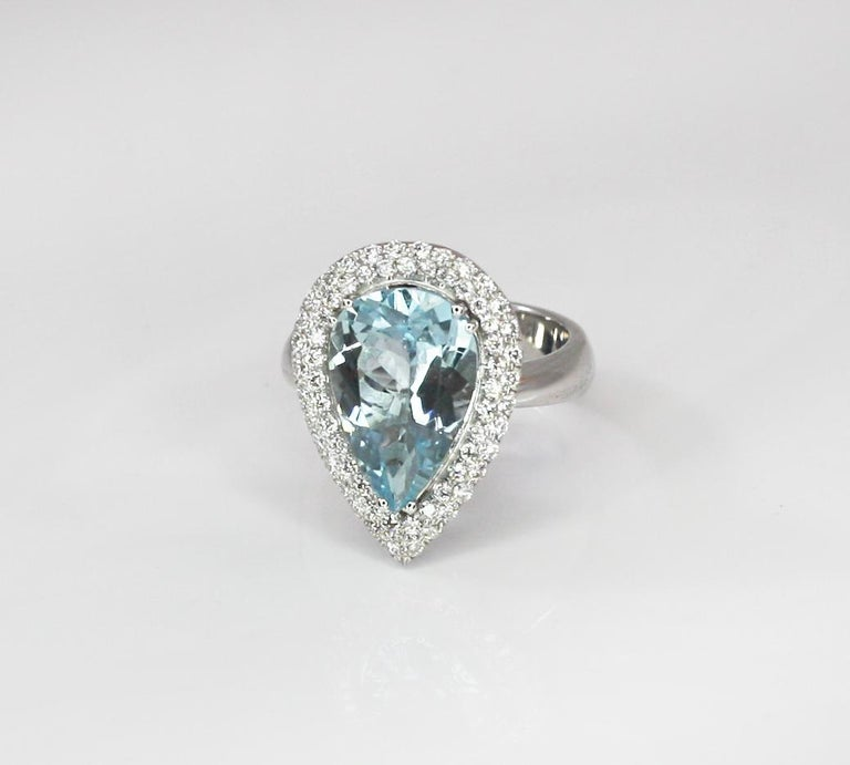 This S.Georgios designer Ring is all hand-made in 18 Karat White Gold and features a stunning color, pear cut natural Aquamarine total weight 4.36 Carat surrounded by natural VVS2 color F brilliant-cut Diamonds total weight of 0.62 Carat. This is a