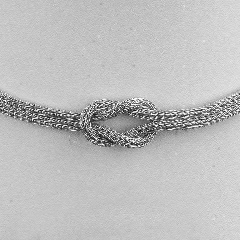 Simple yet striking S.Georgios designer rope necklace with Hercules Knot from 18 Karat white gold all handmade in Greece, knitted in our workshop. The Hercules knot is a symbol of strength, healing and protection and marriage (tying the knot). Each