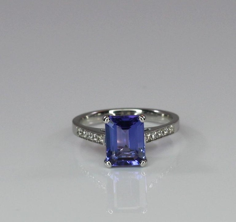 S.Georgios designer ring is White Gold 18 Karat and all hand made. This solitaire ring features an emerald-cut Tanzanite the weight of 2,58 Carat, and brilliant-cut white diamonds total weight of 0.15 Carat. This elegant and classic ring can be also