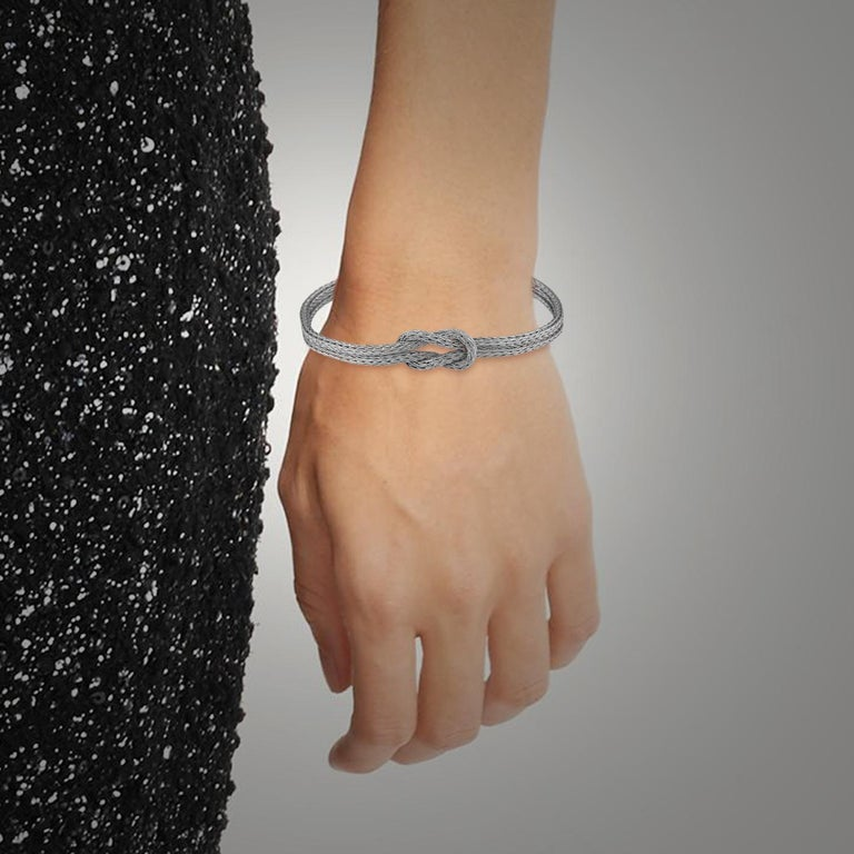 S.Georgios designer Bracelet is solid 18 Karat White Gold and handmade with Byzantine Woven workmanship. This Bracelet is made out of threads of white gold that we knit together. The design in the center is made as a knot which in the Greek