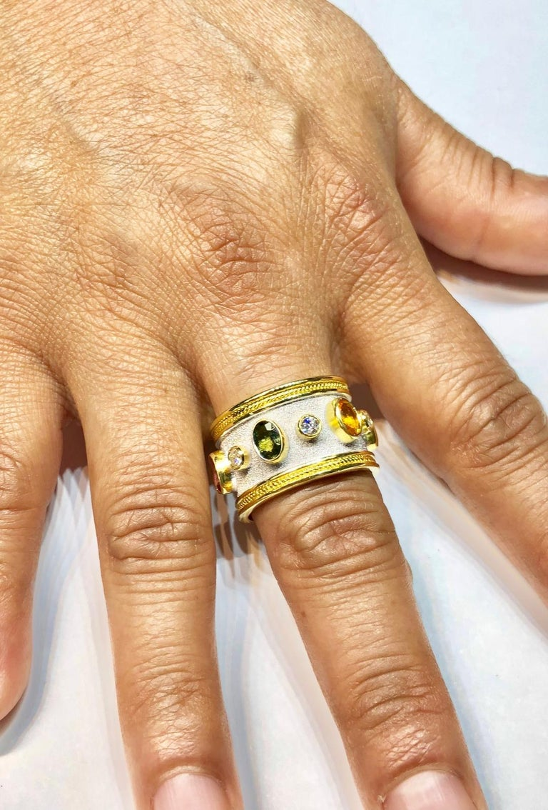 Unique S.Georgios designer 18 Karat Solid Yellow Gold Ring all handmade with the Byzantine workmanship- granulation and a unique velvet look on the background finished in White Rhodium. The ring features 6 Brilliant cut White Diamonds total weight