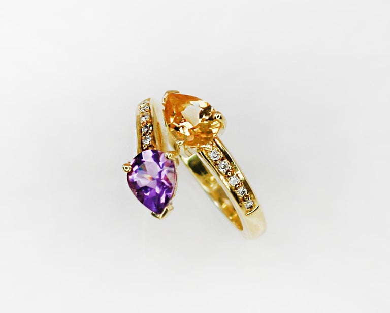 This S.Georgios designer Ring is all hand-made in yellow Gold 18 Karat. It features a solitaire teardrop cut natural Citrine and teardrop natural Amethyst with a total weight of 1.80 Carat and natural white brilliant cut diamonds total weight of