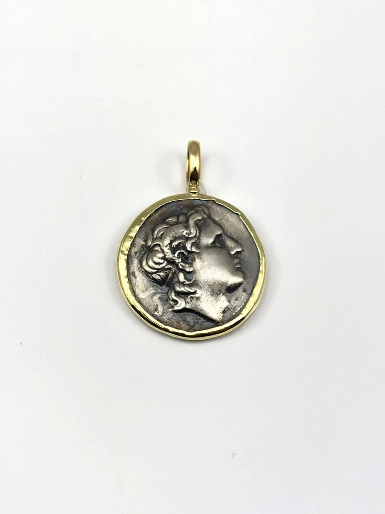 S.Georgios designer 18 Karat Yellow Gold handmade Pendant Necklace featuring a replica of an Ancient Greek Alexander The Great Coin in Silver 925. The coin has a beautiful reverse side and can be worn both ways and the rim and hook of the pendant