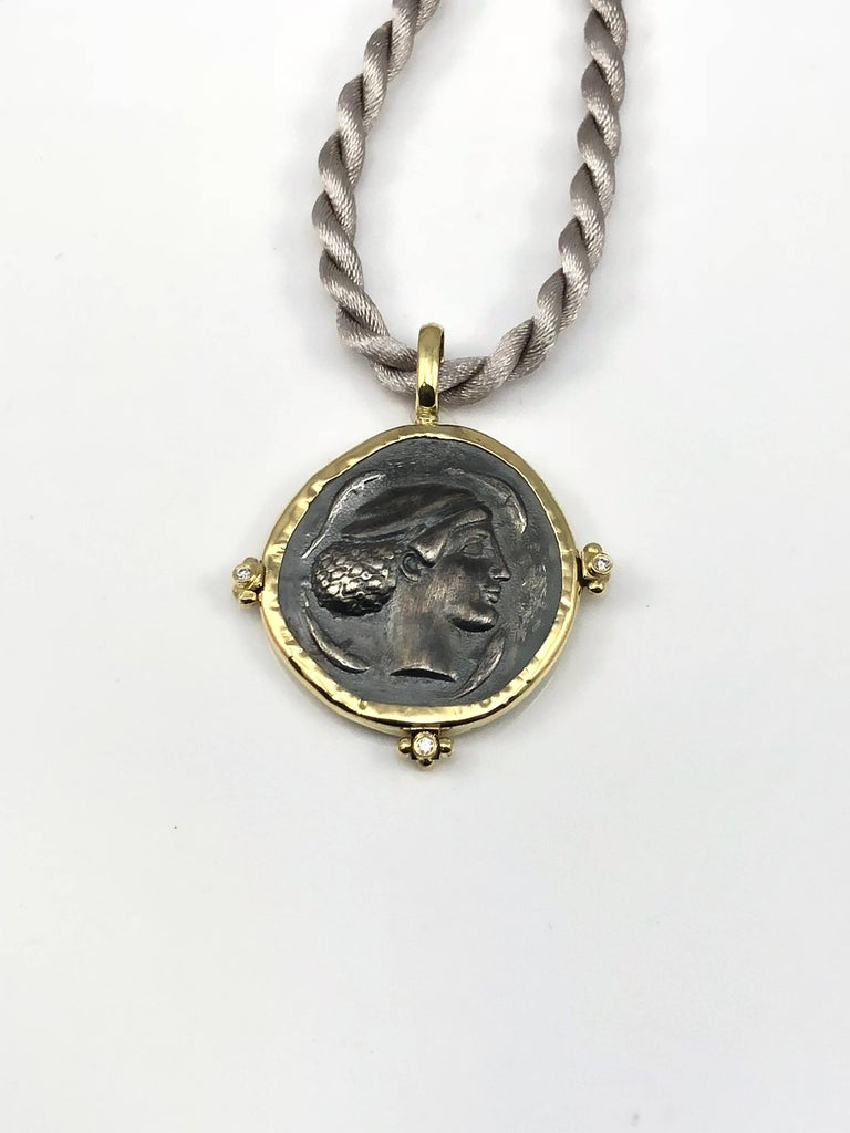 S.Georgios designer 18 Karat Yellow Gold handmade Pendant Necklace featuring 3 Brilliant cut Diamonds total weight of 0.03 Carat and a replica of an Ancient Greek Dimitra Coin in Silver 925. The coin has a beautiful reverse side and can be worn both