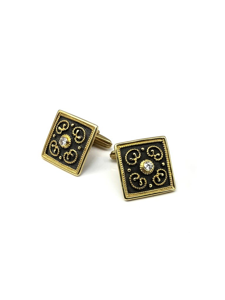 S.Georgios designer Cufflinks Hand Made in 18 Karat Yellow Gold and Black oxidized Rhodium. Cufflinks are microscopically decorated with granulation work in Byzantine style and with unique velvet background. The center features Brilliant Cut