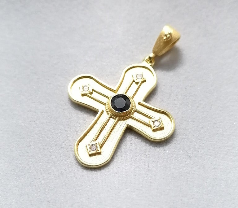 This S.Georgios solid 18 Karat Yellow Gold geometric Cross Pendant is handmade with microscopically decorated Byzantine-style granulation work and finished with a unique velvet background look. This gorgeous necklace features a brilliant-cut natural