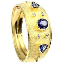 Georgios Collections 18 Karat Yellow Gold Diamond and Tanzanite Bangle Bracelet