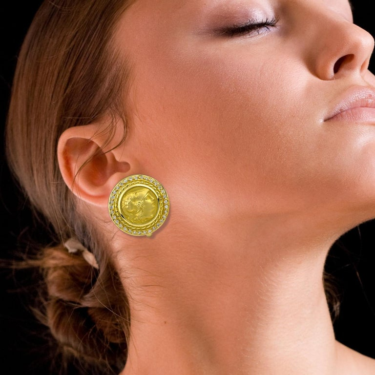 S.Georgios Designer Coin Earrings of Athina are Hand Made from 18 Karat Yellow Gold and feature a Coin of Athina the Goddess of Wisdom and the Protector of Athens. They are also decorated with Byzantine-style workmanship and have Brilliant cut