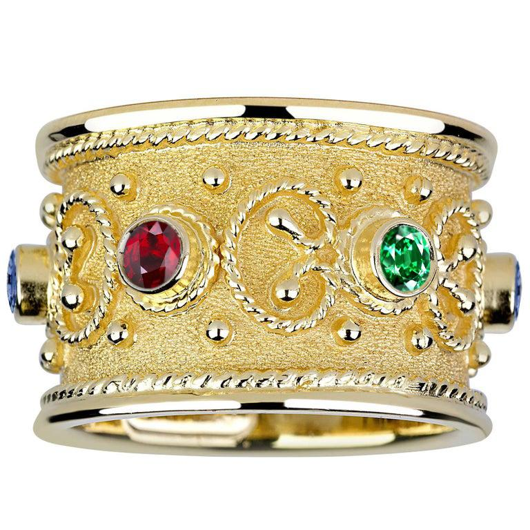 S.Georgios design ring is handcrafted from solid 18 Karat Yellow Gold and is microscopically decorated all the way around with gold beads and wires shaped like the last letter of the Greek Alphabet - Omega, which symbolizes eternal life.  Granulated
