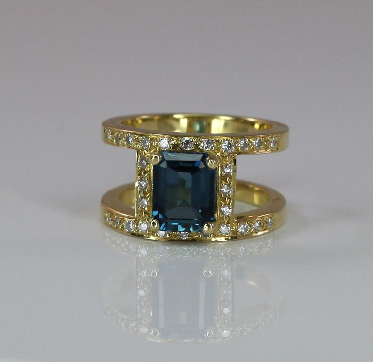 This beautiful S.Georgios designer 18 Karat Solid Yellow Gold Ring is all handmade in our workshop in Greece. The ring features 2.93 Carat Blue Topaz center and 0.30 Carat brilliant cut White Diamonds. The ring can also be ordered in White or Rose