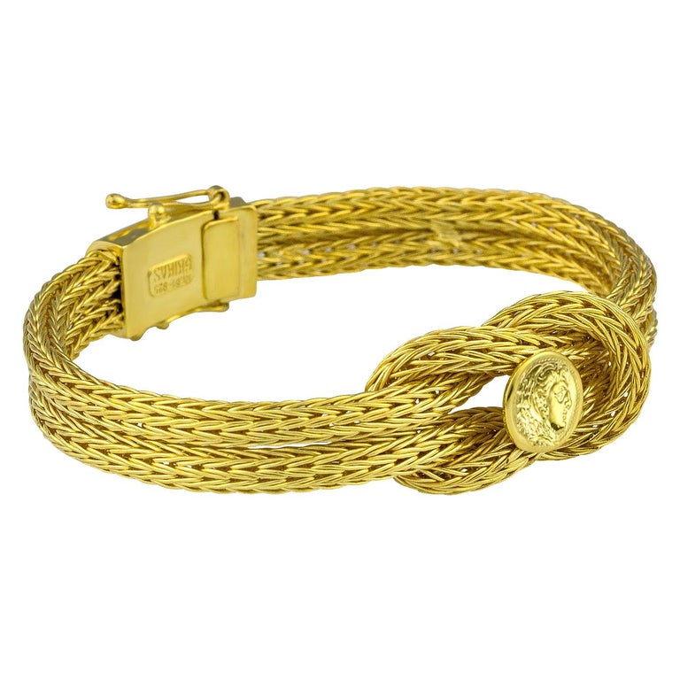 S.Georgios designer bracelet handknitted in our workshop in Greece from 18 Karat yellow gold threads all custom-made. This flexible bracelet decorates Hercules Knot, the symbol of strength, healing, and protection, and a replica of the Alexander The