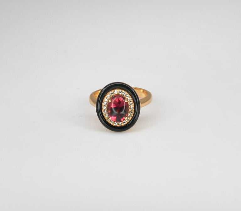 This S.Georgios Designer Ring is all hand-made in yellow Gold 18 Karat. The stunning piece features a solitaire Cabochon Natural Tourmaline with a total weight of 2.00 Carat and natural white brilliant cut diamonds total weight of 0.18 Carat. We