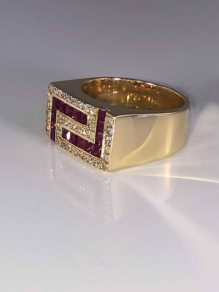 S.Georgios designer 18 Karat Yellow Gold Ring featuring the Greek Key design symbolizing eternity. It is all custom made and has Brilliant Cut White Diamonds total weight of 0.35 Carat and Princess cut Deep Red Rubys total weight of 1.26 Carat. The