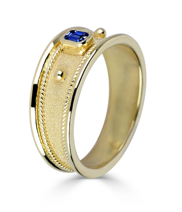 S.Georgios designer band ring in solid 18 Karat Yellow Gold all handmade with the Byzantine workmanship and the unique velvet effect on the background. The granulation on this gorgeous ring has decorations of 22 Karat solid gold. This unisex band