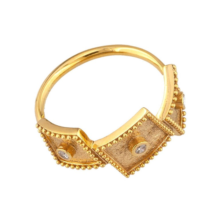 S.Georgios designer thin band ring is 18 Karat yellow gold and microscopically decorated with hand-made granulation workmanship, and finished with a unique contrast velvet look. This beautiful thin band ring features 3 brilliant-cut White Diamonds