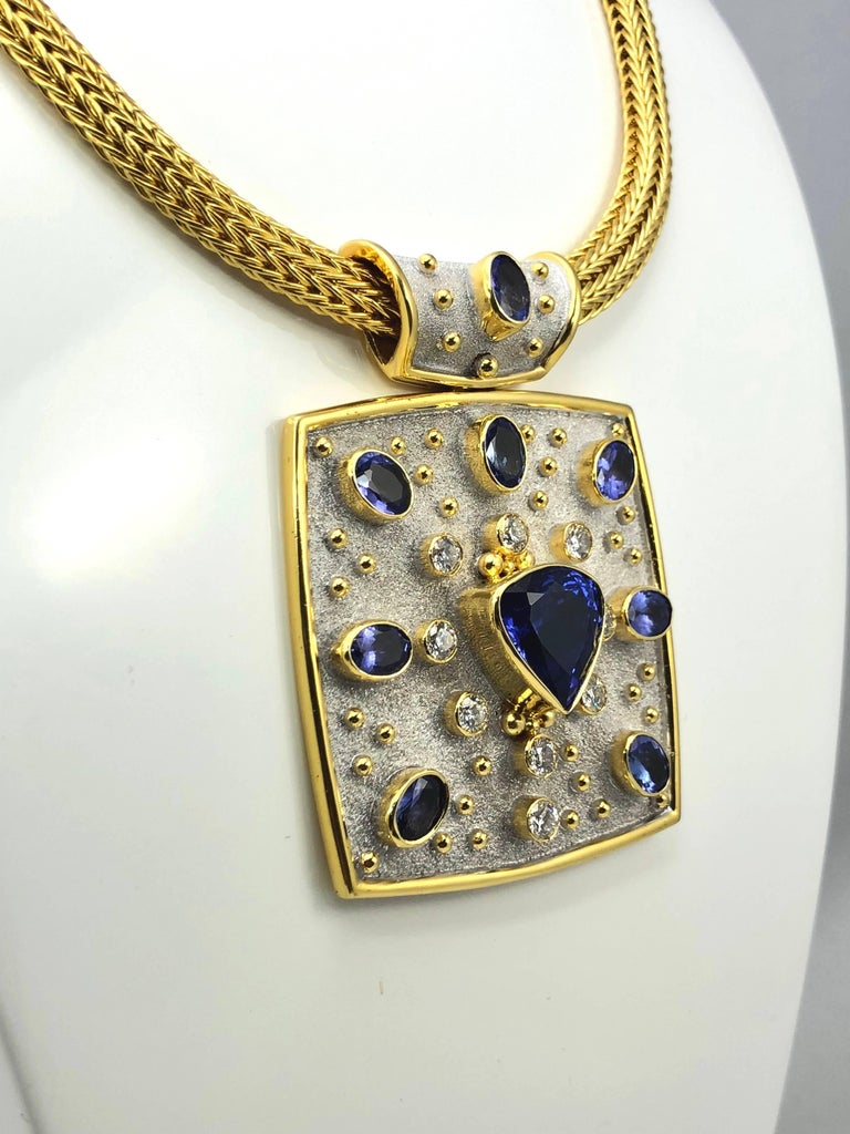 S.Georgios Unique 18 Karat solid Yellow Gold Necklace is one of a kind and is microscopically decorated with 18 Karat gold granulation work and on the background has a gorgeous velvet look with White Rhodium. It features in the center a natural