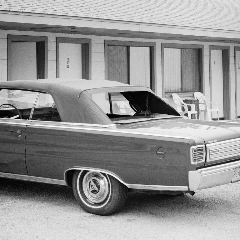 1967 Plymouth, Route 66, USA - Black and White fine art film photography - Photograph by Gerald Berghammer, Ina Forstinger