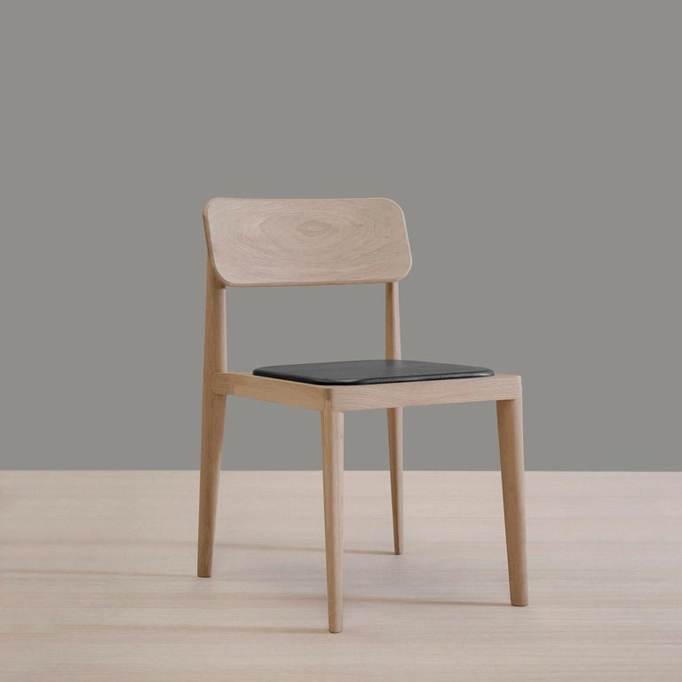 'Gerard,oak and black leather chair was designed by Thai Hua for BREUER ESTUDIO. This pice is part of Linard y Gerard collection in which Thai collaborated with BREUER to create exceptional pieces.   Thai Hua is a Vietnamese industrial designer