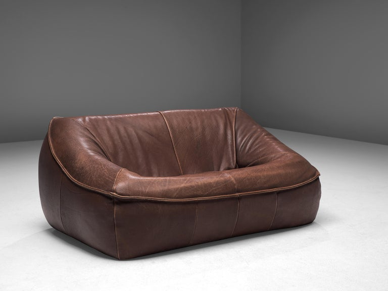 Gerard Van Den Berg for Montis, 'Ringo' sofa, buffalo leather, The Netherlands, 1974  This bulky two-seat 'Ringo' sofa is designed by the Dutch designer Gerard Van Den Berg. The sofa iscomfortable and shaped as a large cushion.The absence of