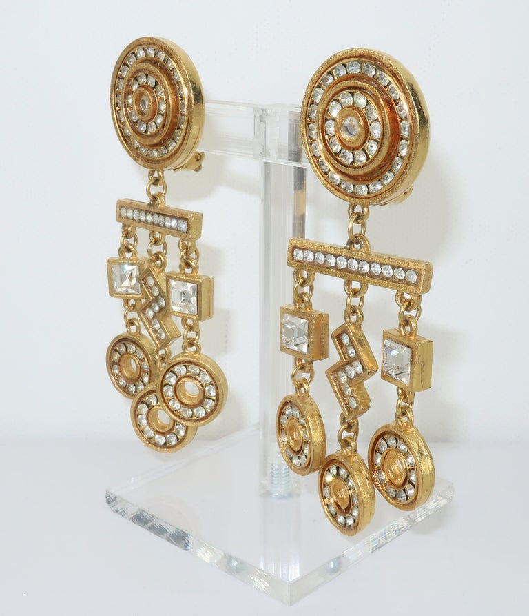 Gerard Yosca gold tone geometric dangle earrings accented by crystal rhinestones.  The statement making design has an Art Deco revival look.  Outfitted with clip on hardware and hallmarked to the back of each earring. CONDITION Very good vintage
