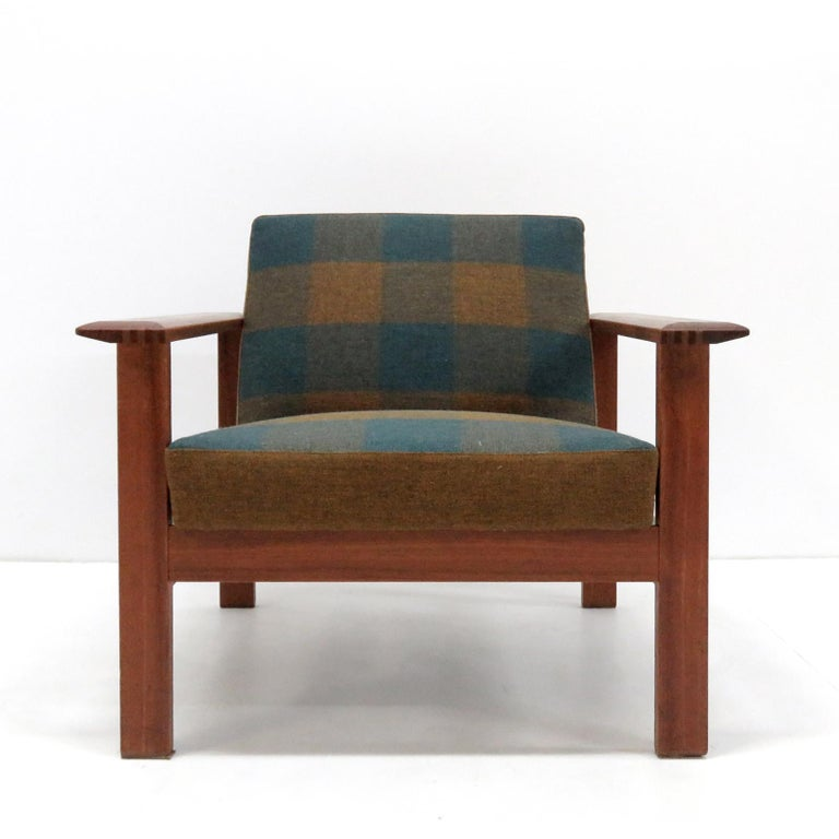 Bold and comfortable Danish modern lounge chairs by Gerhard Berg for Stokke, Norway, 1960s, oversized teak frames with original multicolored tartan fabric in green-blue hues.