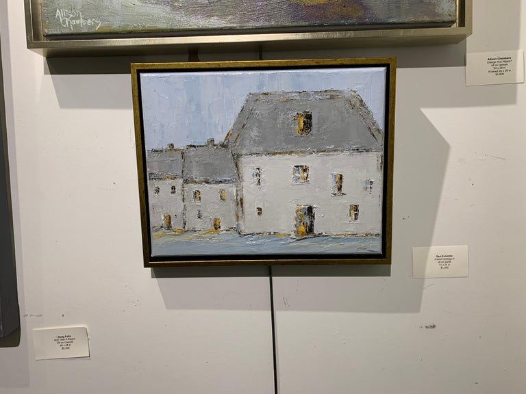 'French Cottage II' is a small framed oil on canvas Impressionist painting created by American artist Geri Eubanks in 2021. Featuring a soft palette made of white, grey, light blue and brown tones, the painting depicts in close view a large barn
