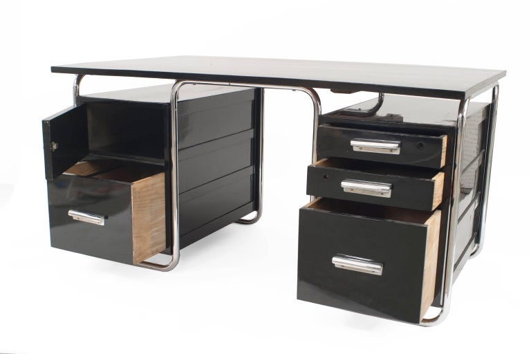 German Art Deco black enameled wood desk with chrome trim having a top floating over two sets of drawers (designed by Marcel Breuer; mfg by Thonet).   His friends and family affectionately called him Lajkó, but the rest of us know him as Marcel