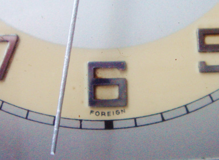 Mid-20th Century German Art Deco Chrome and Butterscotch Marbled Bakelite Electric Desk Clock For Sale