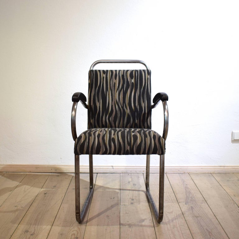 This very rare German Art Deco Tubular steel cantilever armchair was made circa 1925. It was chromed. The chrome come of at some spots but gives the chair a great look and Patina. The chair is re-upholstered in fabric and leather. A very elegant